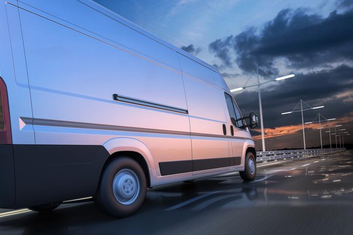 3d rendering of generic van on the road at dawn